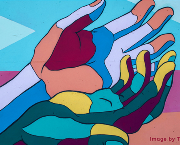 Wall mural featuring multi colored hands