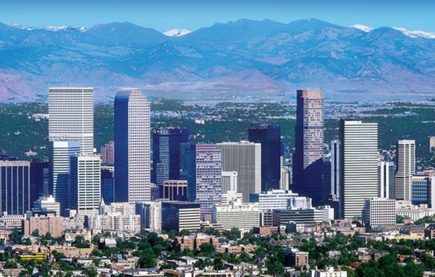 cityscape shot of denver with mountains in background