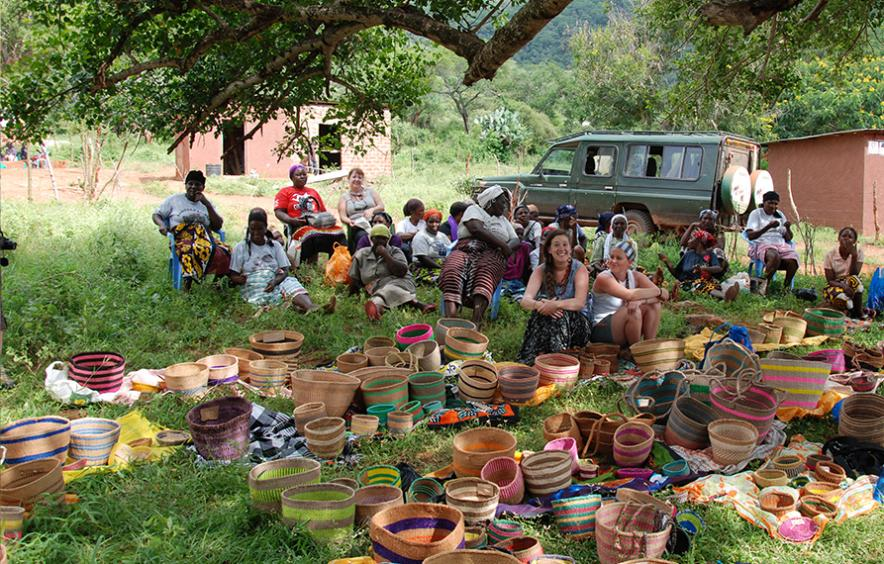 Students at a women's basket weaving cooperative in Kenya