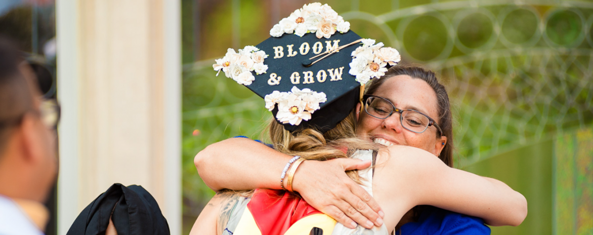 msw graduate with bloom and grow graduation cap
