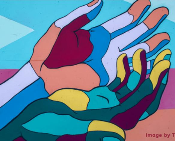 A mural with multi colored hands
