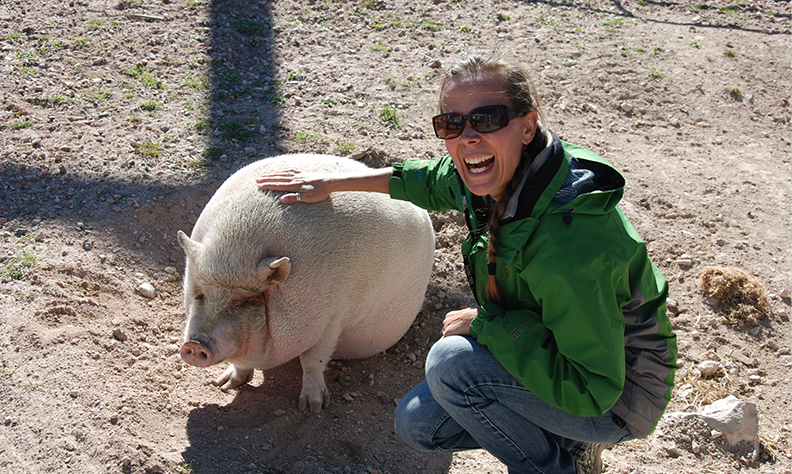 Sarah Bexell with a pig