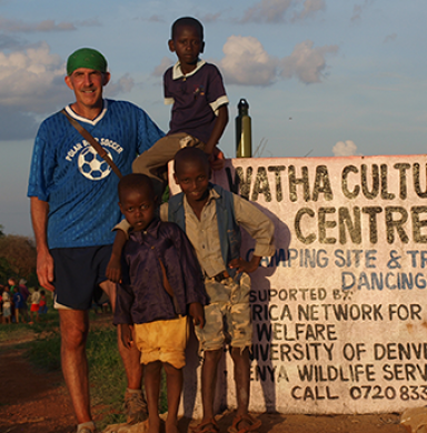 Philip Tedeschi with children in Kenya